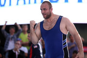 Tervel Dlagnev of the USA celebrates the win over Eduard Bazrov of Russia during the Grapple in the Apple on June 7, 2012 in Times Square in New York, New York.