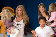 Katie Price, daughter Princess Tiaamii and son Harvey attend the UK premiere of The Lion King 3D at The BFI IMAX Waterloo on September 25, 2011 in London, United Kingdom.