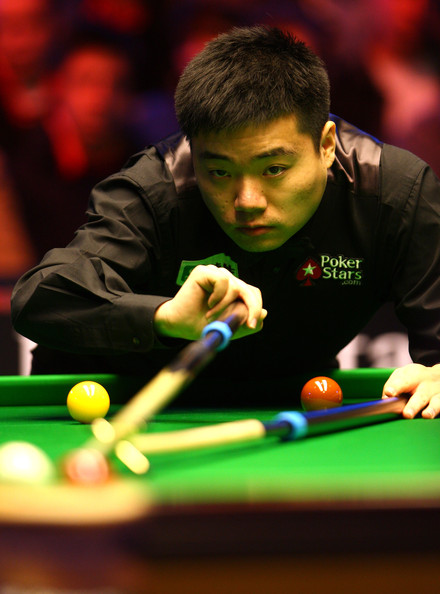 Ding Junhui of China lines up a shot during his game against Mark Selby of England in the PokerStars.com Masters Snooker tournament at Wembley Arena on January 10, 2010 in London, England.