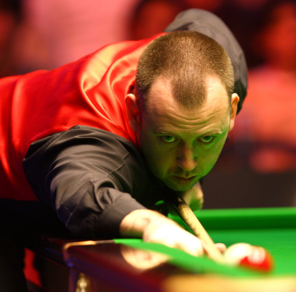 Mark Williams of Wales takes a shot in his second round match against Ali Carter of England during the PokerStars.com Masters at Wembley Arena on January 12, 2010 in London, England.