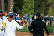 Jordan Spieth of the United States celebrates making birdie on the16th hole with caddie James Johnson during the final round of the 2018 Masters Tournament at Augusta National Golf Club on April 8, 2018 in Augusta, Georgia.