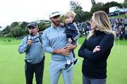 Dustin Johnson of the United States interacts with his partner Paulina Gretzky and son Tatum Gretzky Johnson during a practice round prior to the start of the 2017 Masters Tournament at Augusta National Golf Club on April 3, 2017 in Augusta, Georgia.  (Photo by Harry How/Getty Images) *** Local Caption *** Tatum Gretzky Johnson; Paulina Gretzky; Dustin Johnson