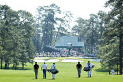Ian Poulter of England, Justin Rose of England and Graeme McDowell of Northern Ireland walk down a fairway with their caddies during a practice round prior to the 2011 Masters Tournament at Augusta National Golf Club on April 4, 2011 in Augusta, Georgia.