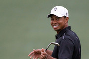 Tiger Woods reacts after a shot during a practice round prior to the start of the 2012 Masters Tournament at Augusta National Golf Club on April 3, 2012 in Augusta, Georgia.