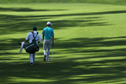 Justin Rose of England walks up the 13th hole with his caddie Mark Fulcher during a practice round prior to the start of the 2018 Masters Tournament at Augusta National Golf Club on April 3, 2018 in Augusta, Georgia.