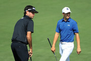 Bubba Watson of the United States and Jordan Spieth of the United States walk across the second green during a practice round prior to the start of the 2018 Masters Tournament at Augusta National Golf Club on April 3, 2018 in Augusta, Georgia.