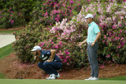 Dustin Johnson and Jordan Spieth of the United States lines up a putt on the 13th green during the third round of the 2018 Masters Tournament at Augusta National Golf Club on April 7, 2018 in Augusta, Georgia.