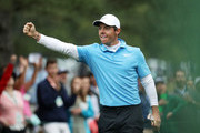 Rory McIlroy of Northern Ireland celebrates making eagle on the eighth hole during the third round of the 2018 Masters Tournament at Augusta National Golf Club on April 7, 2018 in Augusta, Georgia.