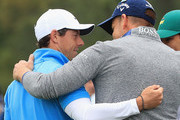 Rory McIlroy of Northern Ireland and Henrik Stenson of Sweden greet eachother on the first hole during the third round of the 2018 Masters Tournament at Augusta National Golf Club on April 7, 2018 in Augusta, Georgia.