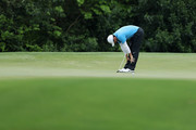 Rory McIlroy of Northern Ireland reacts to his par putt on the fifth green during the third round of the 2018 Masters Tournament at Augusta National Golf Club on April 7, 2018 in Augusta, Georgia.