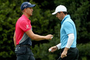 (L-R) Henrik Stenson of Sweden and Rory McIlroy of Northern Ireland wave as they walk across the sixth green during the third round of the 2018 Masters Tournament at Augusta National Golf Club on April 7, 2018 in Augusta, Georgia.