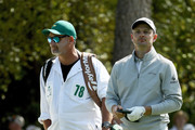 Justin Rose of England waits with caddie Mark Fulcher on the first hole during the second round of the 2018 Masters Tournament at Augusta National Golf Club on April 6, 2018 in Augusta, Georgia.