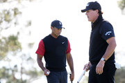 Phil Mickelson and Tiger Woods react on the fifth green during The Match: Tiger vs Phil at Shadow Creek Golf Course on November 23, 2018 in Las Vegas, Nevada.