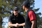 Tiger Woods and Phil Mickelson shake hands prior to The Match: Tiger vs Phil at Shadow Creek Golf Course on November 23, 2018 in Las Vegas, Nevada.
