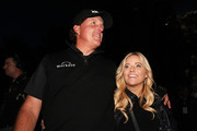 Phil Mickelson celebrates with his wife Amy after defeating Tiger Woods during The Match: Tiger vs Phil at Shadow Creek Golf Course on November 23, 2018 in Las Vegas, Nevada.