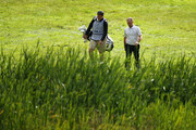 David Higgins of the Great Britain and Ireland PGA Cup team makes his way to the green with his caddy during the morning fouball matches on day 1 of the 28th PGA Cup at Foxhills Golf Course on September 15, 2017 in Ottershaw, England.
