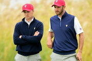(L-R) Jordan Spieth and Dustin Johnson of the United States Team watch play against Jason Day and Charl Schwartzel of the International Team during the Saturday foursomes matches at The Presidents Cup at Jack Nicklaus Golf Club Korea on October 10, 2015 in Songdo IBD, Incheon City, South Korea.