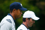 Tiger Woods of the USA Team walks with Mike Weir of the International Team on the first hole during the Day Three Morning Foursome Matches of The Presidents Cup at Harding Park Golf Course on October 10, 2009 in San Francisco, California.
