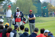 Jordan Spieth of the United States team lines up his second shot with his partner Dustin Johnson on the 15th hole in their match against Charl Schwartzel and Jason Day of the International Team during the Saturday morning foursomes matches at The Presidents Cup at Jack Nicklaus Golf Club Korea on October 10, 2015 in Songdo IBD, Incheon City, South Korea.