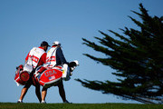 USA Team caddies Steve Williams and Jimmy Johnson walk up the 15th hole during the Day Two Fourball Matches of The Presidents Cup at Harding Park Golf Course on October 9, 2009 in San Francisco, California.