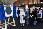 Queen Elizabeth II unveils a commemorative plaque to mark her visit to the Chichester Theatre on November 30, 2017 in Chichester, United Kingdom.