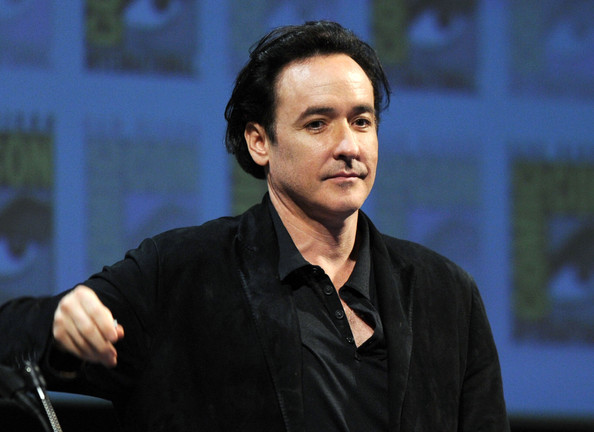 "Actor John Cusack speaks at ""The Raven"" Panel during Comic-Con 2011 on July 22, 2011 in San Diego, California."