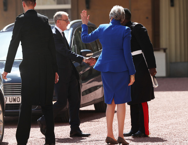 Queen Receives Outgoing And Incoming Prime Ministers [suit,uniform,standing,white-collar worker,formal wear,event,bodyguard,gesture,official,tuxedo,philip may,theresa may,prime ministers,queen,prime minister,monarch,nana twumasi-ankrah,number,palace,major]