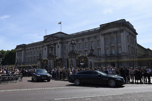 Queen Receives Outgoing And Incoming Prime Ministers [vehicle,car,architecture,building,town,city,palace,house,tourism,street,theresa may,prime ministers,queen,prime minister,monarch,seats,british,buckingham palace,palace,government]