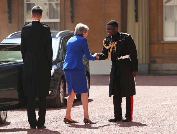 Queen Receives Outgoing And Incoming Prime Ministers [uniform,standing,official,conversation,tourism,gesture,bodyguard,theresa may,prime ministers,queen,prime minister,monarch,nana twumasi-ankrah,number,seats,palace,household cavalry regiment]