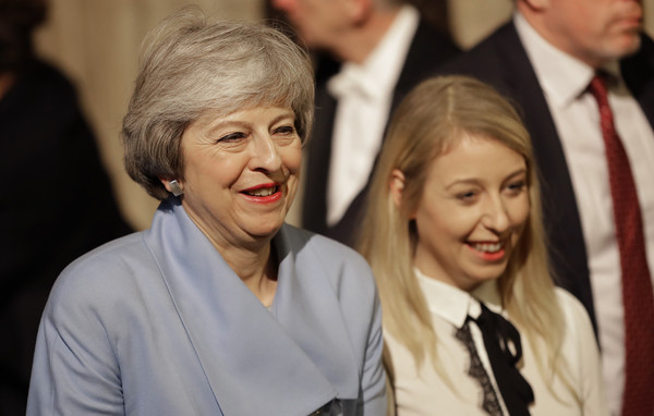 State Opening Of Parliament [theresa may,members,elizabeth ii,facial expression,people,lady,event,human,smile,photography,family pictures,family,state opening of parliament,state opening,speech,parliament,parliament,commons members lobby,government]