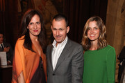 (L-R) Executive vice president of Barneys Daniella Vitale, CEO of Barneys Mark Lee and Barneys fashion director Amanda Brooks attend the Thom Browne Spring 2012 presentation during Mercedes Benz Fashion Week at The New York Public Library on September 12, 2011 in New York City.