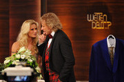 "Michelle Hunziker hands over personal presents to Thomas Gottschalk during the 199th ""Wetten dass...?"" show at the Rothaus Hall on December 3, 2011 in Friedrichshafen, Germany. After 24 years host Thomas Gottschalk terminates today his career as ""Wetten dass...?"" moderator."