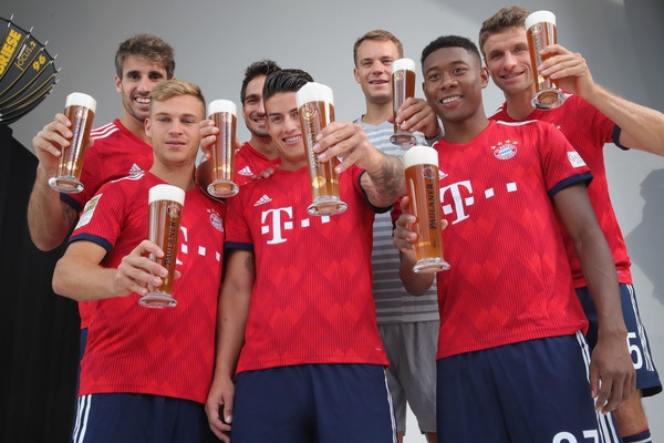 FC Bayern Muenchen And Paulaner Photo Session [team,social group,youth,team sport,player,sports,tournament,competition event,championship,competition,niko kovac,partner,javier martinez,joshua kimmich,l-r,germany,fc bayern muenchen,paulaner,football team,photo session]