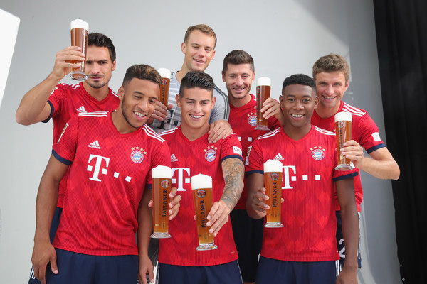 FC Bayern Muenchen And Paulaner Photo Session [team,social group,red,team sport,youth,player,sportswear,sports,jersey,t-shirt,niko kovac,partner,mats hummels,corentin tolisso,l-r,germany,fc bayern muenchen,paulaner,football team,photo session]