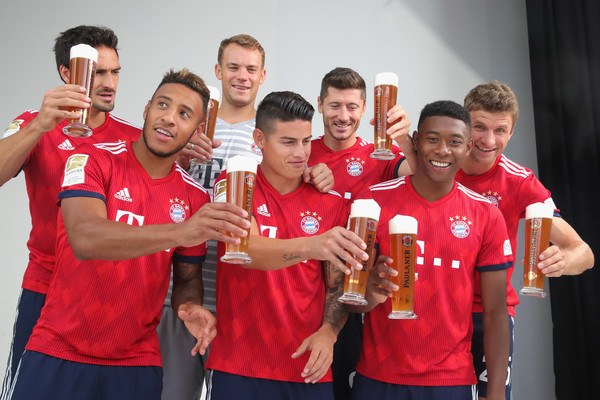 FC Bayern Muenchen And Paulaner Photo Session [team,social group,red,youth,player,championship,team sport,competition event,event,sports,niko kovac,partner,mats hummels,corentin tolisso,l-r,germany,fc bayern muenchen,paulaner,football team,photo session]
