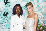 Justine Skye (L) and Hailey Baldwin attend the Tiffany & Co. Paper Flowers event and Believe In Dreams campaign launch on May 3, 2018 in New York City.