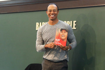 Tiger Woods Tiger Woods Signs Copies Of His New Book 'The 1997 Masters: My Story'
