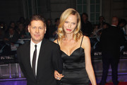 (UK TABLOID NEWSPAPERS OUT) Andrew Niccol and Rachel Roberts attend the UK premiere of 'In Time' at The Curzon Mayfair on October 31, 2011 in London, United Kingdom.