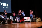 (L-R) Michael Trotter, Tanya Trotter, Naomi Ekperigin, Jennifer Rudolph Walsh, Ashley C. Ford, Abby Wambach and Ruthie Lindsey bond onstage at Together Live Royal Oak at the Royal Oak Music Theatre on October 24, 2019 in Royal Oak, Michigan.