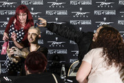 Bill Kaulitz (2L) and Tom Kaulitz (2R) pose with fans after the Tokio Hotel Press Conference & Photocall on October 2, 2014 in Berlin, Germany. After a five year break, the new Tokio Hotel record 'Kings Of Suburbia' will be released on October 3.