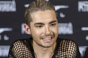 Bill Kaulitz talks to fans after the Tokio Hotel Press Conference & Photocall on October 2, 2014 in Berlin, Germany. After a five year break, the new Tokio Hotel record 'Kings Of Suburbia' will be released on October 3.