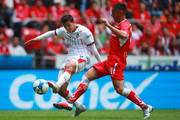 Angel Zaldivar #14 of Chivas struggles for the ball with Osvaldo Gonzalez #4 of Toluca during the third round match between Toluca and Chivas as part of the Torneo Apertura 2018 Liga MX at Nemesio Diez Stadium on August 5, 2018 in Toluca, Mexico.
