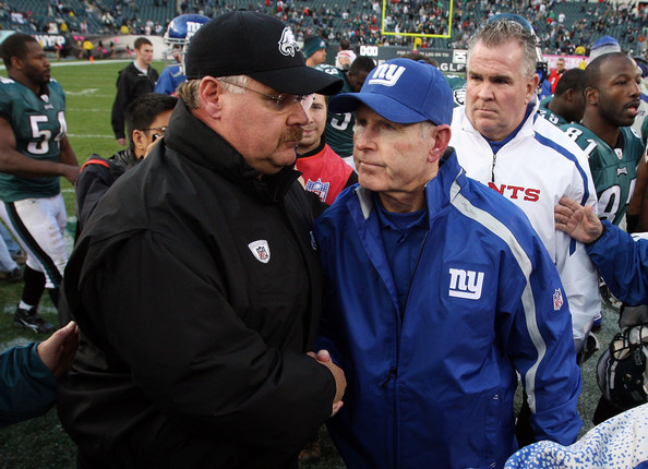 New York Giants v Philadelphia Eagles [product,fan,coach,team sport,stadium,event,championship,team,crowd,competition event,andy reid,tom coughlin,hands,pennsylvania,philadelphia,lincoln financial field,philadelphia eagles,new york giants,game]