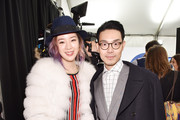 Irene Kim and Ricky Kwok pose backstage at Tommy Hilfiger Women's during Mercedes-Benz Fashion Week Fall 2015 at Park Avenue Armory on February 16, 2015 in New York City.