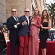 Tommy Hilfiger and Thalia Photos