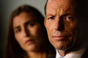 Opposition Leader, Tony Abbott addresses the media as his daughter Francis Abbott looks on at the Rosella Factory on September 5, 2013 in Dandenong, Australia. The Liberal-National Party coalition released their costings this afternoon in Melbourne. Asylum seekers, broadband, and climate Direct Action - three of the coalition's key policies - have not been submitted to the independent Parliamentary Budget Office.