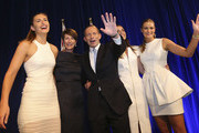 Newly elected Prime Minister Tony Abbott and his family  from right, Bridget, Louise, wife Margaret and Frances wave after he delivered his victory speech on September 7, 2013 in Sydney, Australia. Liberal-National Coalition leader Tony Abbott was elected Prime Minister in a landslide victory over Labor leader Kevin Rudd, bringing the conservative party to power for the first time in six years.