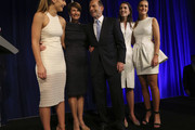 Newly elected Prime Minister Tony Abbott and his family, from right, Bridget, Louise, wife Margaret and Frances smile together after he delivered his victory speech on September 7, 2013 in Sydney, Australia. Liberal-National Coalition leader Tony Abbott was elected Prime Minister in a landslide victory over Labor leader Kevin Rudd, bringing the conservative party to power for the first time in six years.
