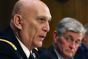 Army Chief of Staff Gen. Raymond Odierno (L) testifies while Secretary of the Army John McHugh listens, during a Senate Armed Services Committee hearing on Capitol Hill March 18, 2015 in Washington, DC. The committee was hearing testimony on President Obamas Defense Authorization Request for FY2016 for of the Department of the Army and the Department of the Air Force.