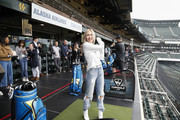 Cassie Randolph (L) and Colton Underwood join thousands in Topgolf's Guinness Book World Record attempt for most golf balls hit simultaneously at Oracle Park in San Francisco, California and all Topgolf venues around the world on November 7, 2019.